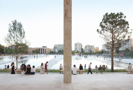 The Skanderbeg Square in Tirana, Albania: a pedestrian square, slightly raised towards the center, surrounded by an urban forest (project by 51N4E, Anri Sala, Plant en Houtgoed, iRI, picture by Filip Dujardin)